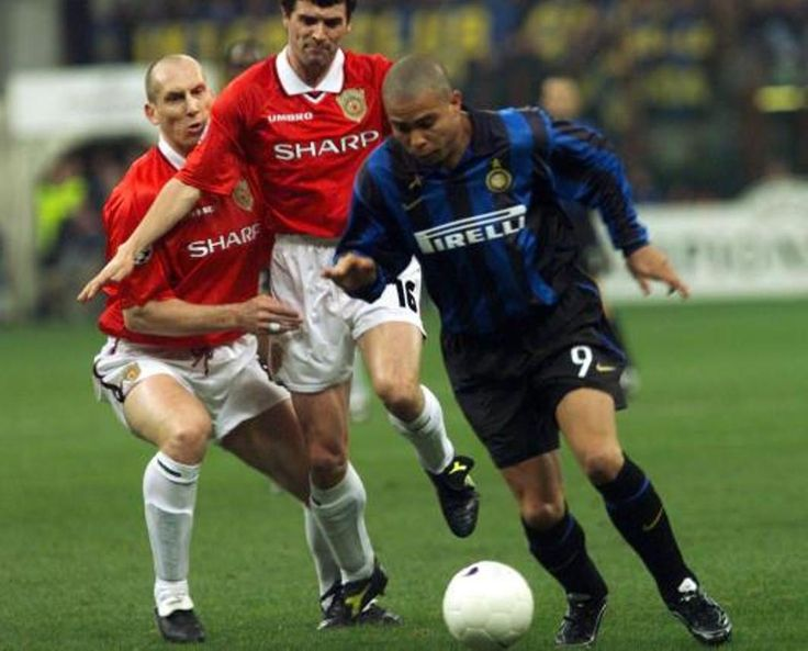 Jaap Stam and Roy Keane with Ronaldo