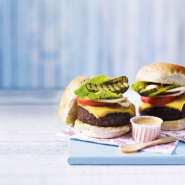Tender beef burgers topped with amazing home-made cheese slices and served with charred gherkins and a zingy sauce, offer the perfect balance to create my ultimate cheeseburger -  Heston.   Find the recipe on the Waitrose website.
