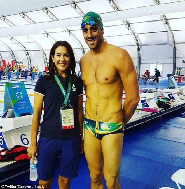 Showing her support: Princess Mary visited members of the Danish swimming team during a tr...