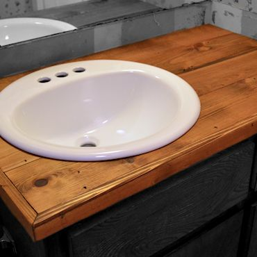 Instructions for DIY wood bathroom counter top for $34.11 in materials + tools (jigsaw, nail gun, miter saw, electric sander)
