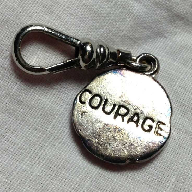 "Small ""courage"" charm."