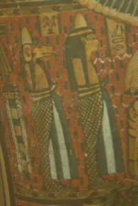 A common inclusion in burials, either as models or paintings, were the Four Sons Of Horus, the guardians of the internal organs. The examples shown here are painted on a coffin lid in the N.M.S.