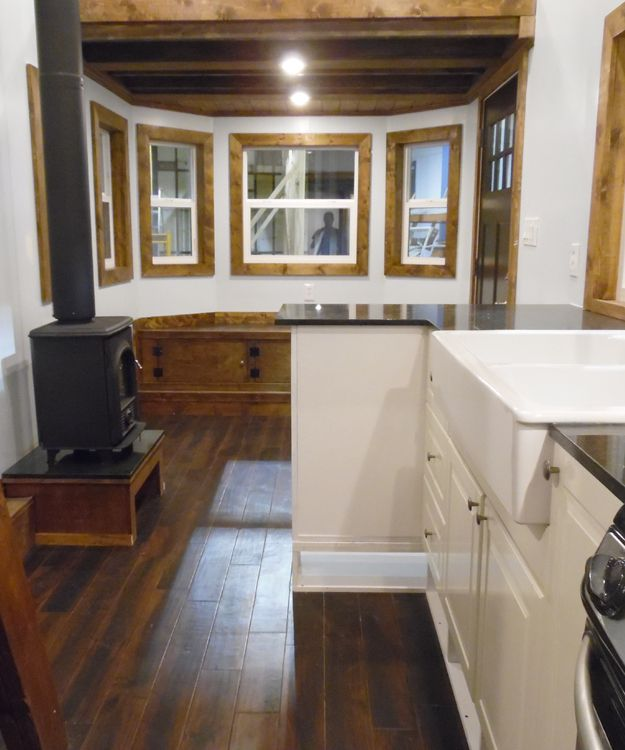 The kitchen includes granite countertops with a peninsula, a farmhouse sink, IKEA cabinets, a freestanding range, and a French door refrigerator.