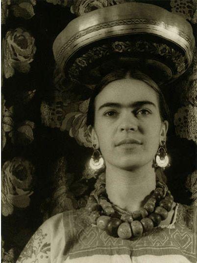 Photo by Carl Van Vechten, 1932, Frida (25) wearing a Tchuantepee gourd.