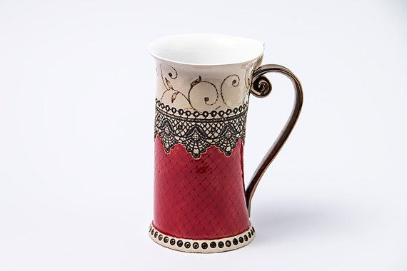 Teacup or coffee cup with red decoration handmade pottery with glazed cover.    This is the perfect cup for your morning hot coffe,tea or other