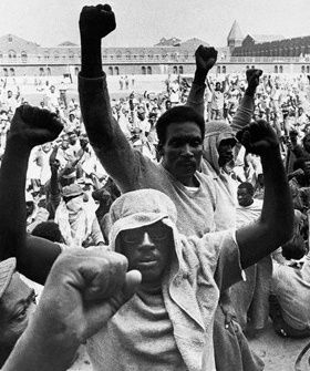 This is a famous photograph capturing prisoners during the 1971 Attica Prison Rebellion.