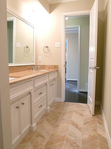 Renovation #2 - jack 'n jill bathroom, double vanity, travertine chevron tiled floors
