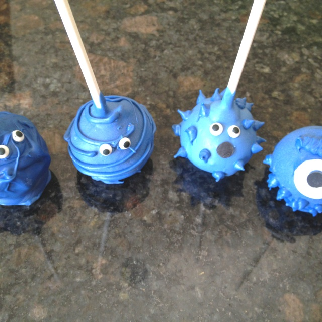 Lil' Monster cake pops for a boys baby shower with red velvet centers!  www.vanillabean-bakery.com in Indianapolis!
