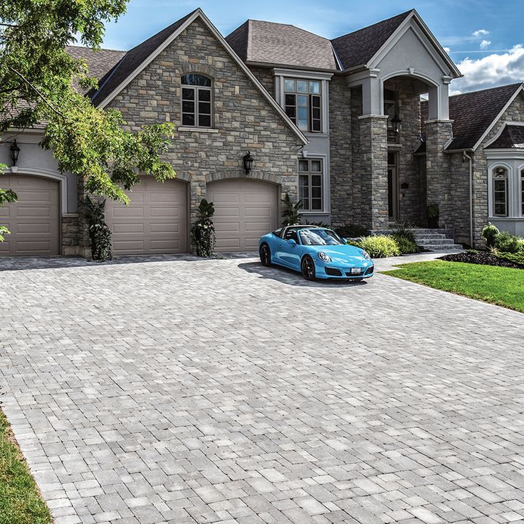 Driveway and walkway landscape. Project application using Wexford  pavers. Color: Wexford Grey Granite by Oaks Landscape Products.