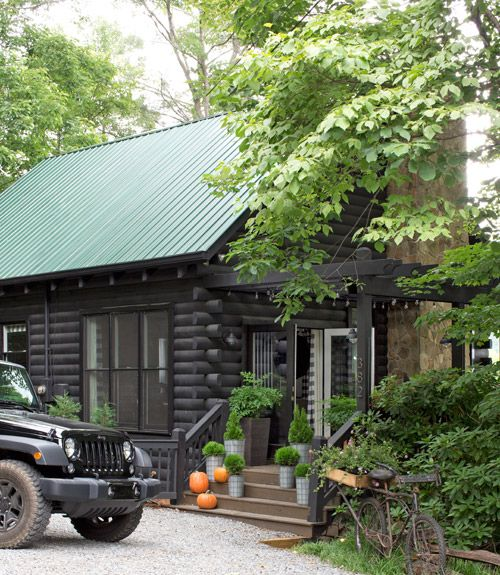 """This Georgia log cabin's solid wood French doors (in place of the original aluminum ones) say """"Come on in,"""" not """"Keep out!"""""""