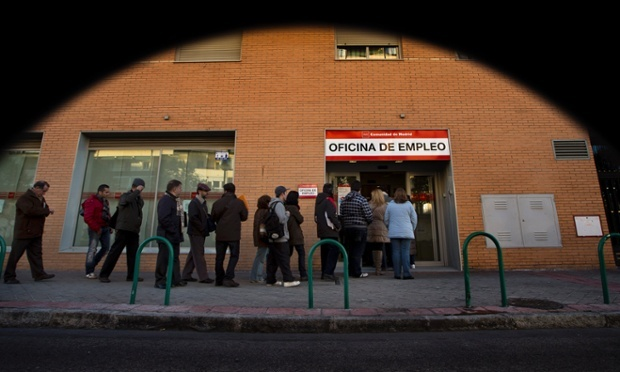 People queue to enter an unemployment office in Madrid. Labour Ministry figures released today showed the registered jobless figure went up by 132,055 in January to 4.98 million. Photograph: Daniel Ochoa De Olza/AP