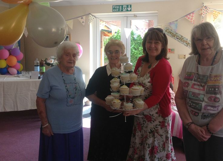 The girls getting the room ready for Nellies Birthday party at Birch Green Care Home - wow look at them cakes x