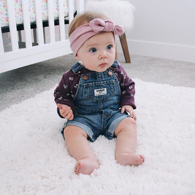 """Someone's starting to sit up on her own... And wear overalls. #toomuchtohandle"" Photo taken by @kaleymunday on Instagram. #hebegoals"