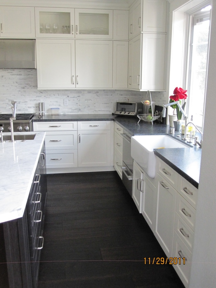 25 best ideas about super white granite on pinterest for White kitchen cabinets with black island