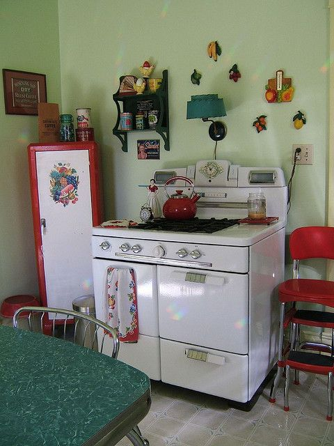 1950's kitchen - love that stove, red metal stool, and fruit chalkware- could use a pretty locker like that one in the corner