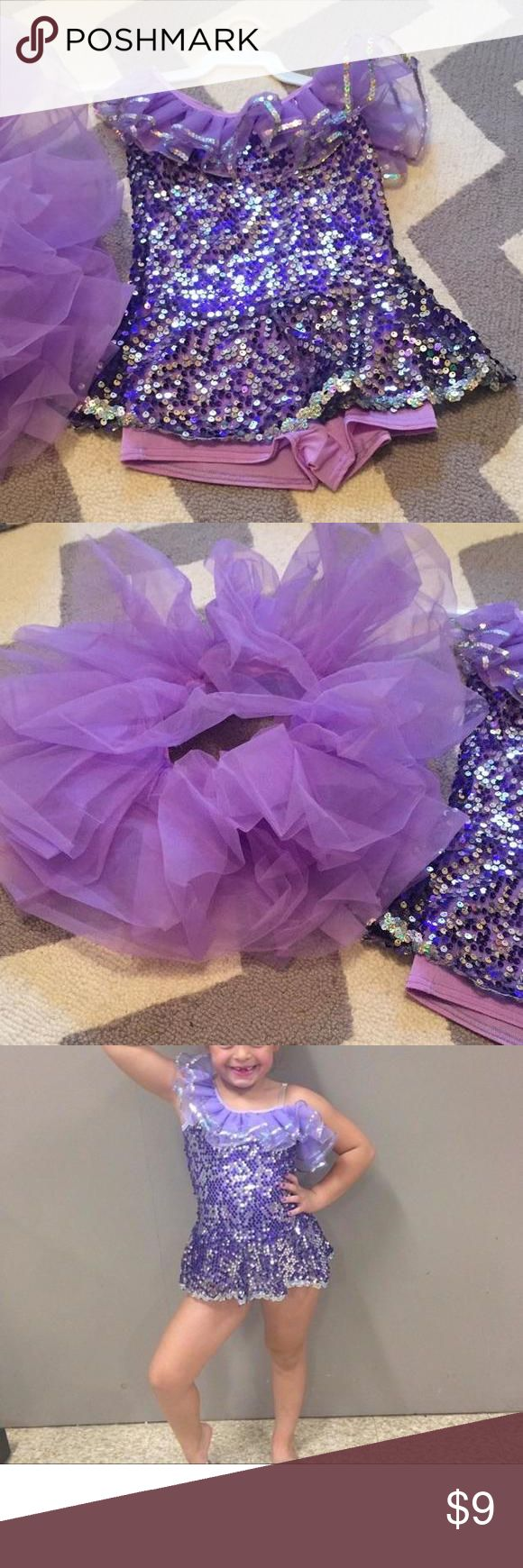 Dance costume Great for Halloween or dress up! Worn one time. Purple body suit with sequin overlay and detachable purple tutu. Sz. Child medium- equivalent to about a 6 Costumes Dance