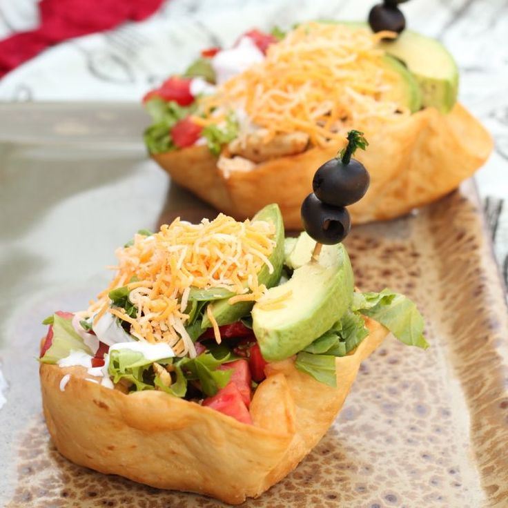 fried tortilla shell taco salad w grilled chicken. I'd make a mexi-ranch dressing to go with this.