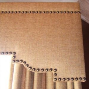 Linen covered cornice boards with nailhead trim