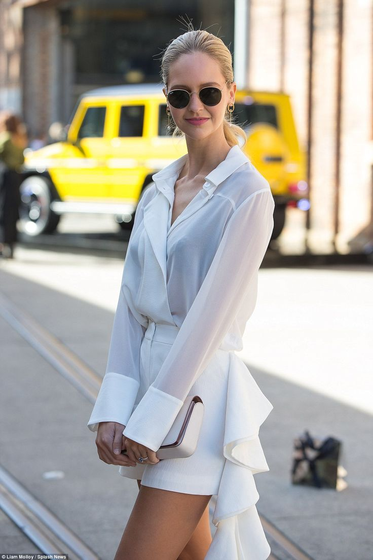 White hot: BloggerSaasha Burns took a modern twist on a two-piece in shorts and a blouse, carrying a cream clutch bag with her