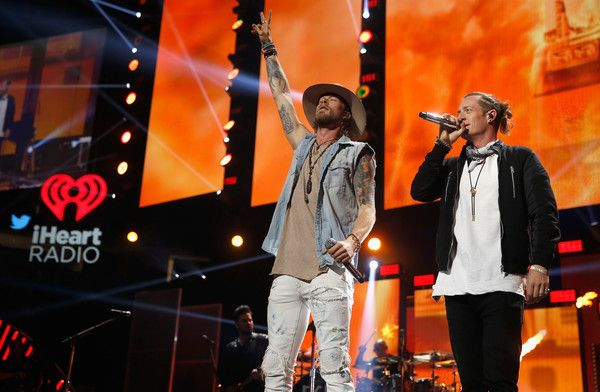 Brian Kelley Photos Photos - Musicians Brian Kelley (L) and Tyler Hubbard of Florida Georgia Line  perform onstage at the 2016 iHeartRadio Music Festival at T-Mobile Arena on September 24, 2016 in Las Vegas, Nevada. - 2016 iHeartRadio Music Festival - Night 2 - Show