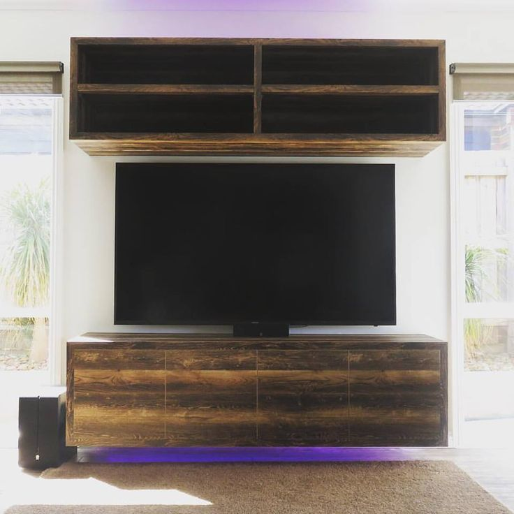 Floating TV unit made from Abbeywood NavUrban @newageveneers and thanks to the guys from Albedor Industries for supplying a beautiful product that looks towards a sustainable and environmentally future for the industry 🌲🍃 #tvunit #navurban #floating #lighting #custommade #interiordesign #livingroom #design #interior #sustainable #green #nosiva_custom_cabinetry — with Albedor Industries Pty Ltd. Photo supplied by https://www.facebook.com/nosivacustomcabinetry/