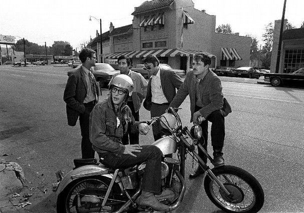 The five men who founded TGI Friday's Memphis and Overton Square in 1970, shortly after the opening of Friday's. In a helmet on the motorcyc...