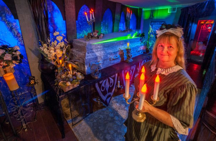 JOAN PAHOYO/Acorn Newspaper Sandie Schneider of Camarillo photographed in her home on Tuesday, October 27, 2015 has converted her house into a replica of the Haunted Mansion ride at Disneyland.