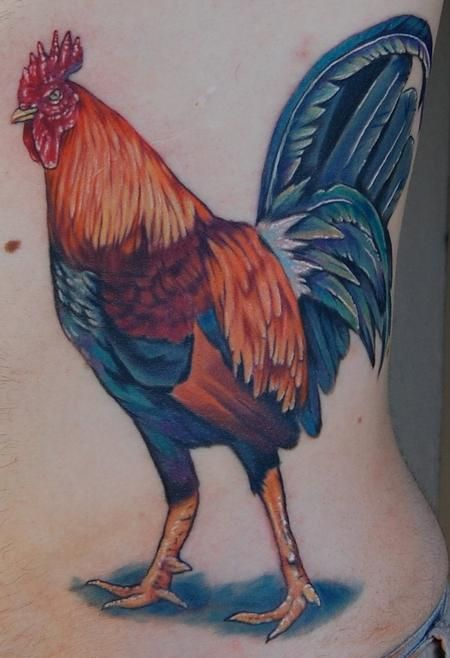 Rooster tattoos are a colorful symbol of leadership. masculine power and pride.