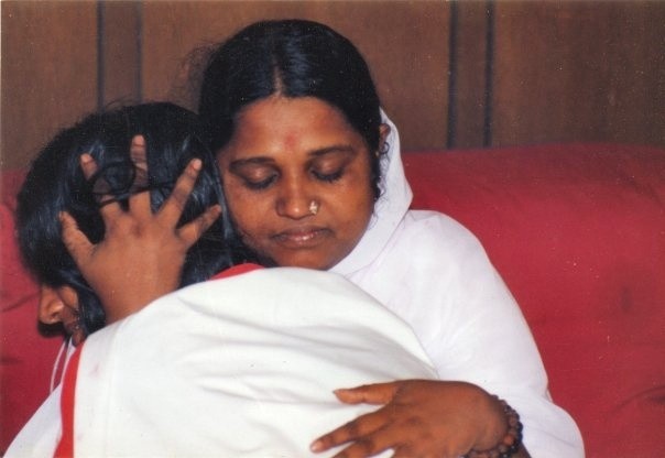 Ammachi giving darshan to Shree Maa