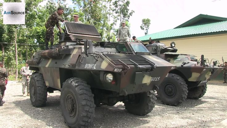 US Soldiers Checking Out Philippine Army's Commando & Simba Armored Vehi...