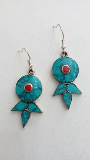 Tibetian earnings  Made in German silver with coral and turquoise  Price $20 Email on saagoshroff@gmail.com to avail  (free delivery in India)