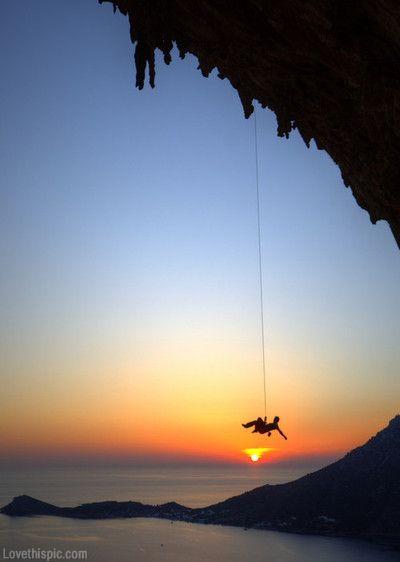 Hanging on sky sunset ocean water mountain rocks climbing sport