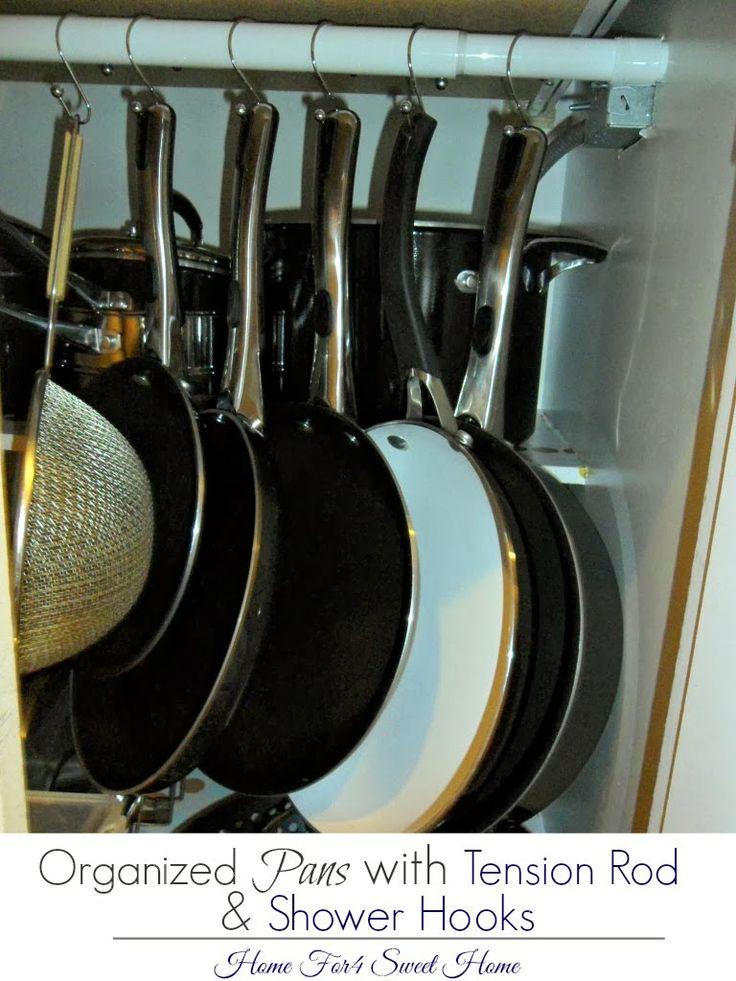 organizing pans with tension rod shower hooks organizing kitchen pinterest hooks why. Black Bedroom Furniture Sets. Home Design Ideas