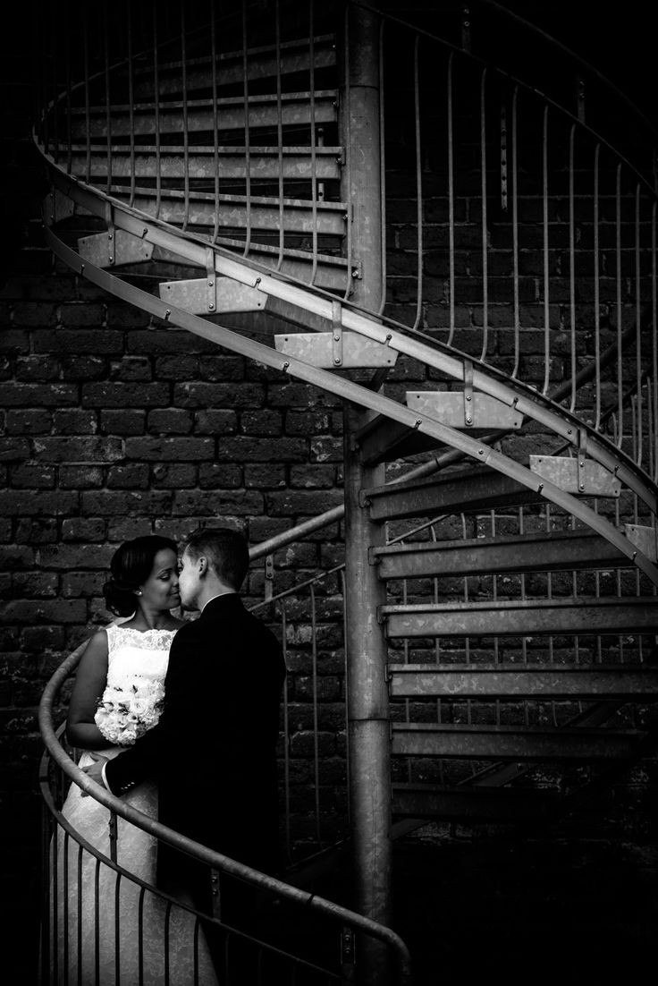 Wedding portrait in steel stairway. Industrial style.