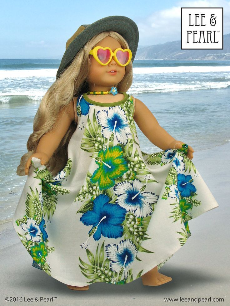 """Our American Girl doll Caroline is wearing a floppy denim hat made using Lee & Pearl Pattern 1017: California Girl Sunhat for 18"""" Dolls and the perfect summer sundress, made using Pattern 1032: Desert Sunrise Maxi Dress, Halter Top and Chokers for 18 Inch Dolls. Find these adorable, easy-to-sew summer patterns in the Lee & Pearl Etsy store at https://www.etsy.com/shop/leeandpearl"""