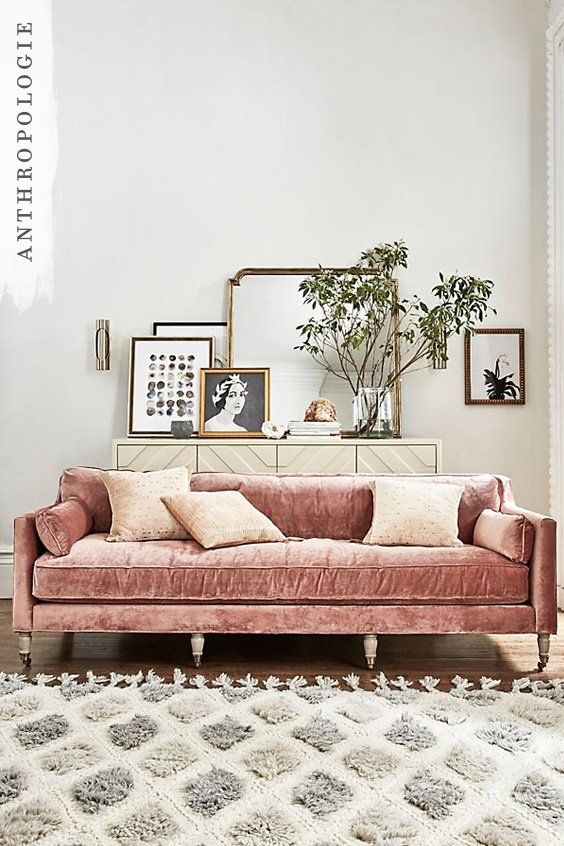 This living room idea combines Pantone 2016 colour of the year Rose Quartz with some old school bronze details for decor.