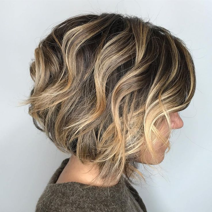Curly Jaw-Length Bob with Choppy Layers