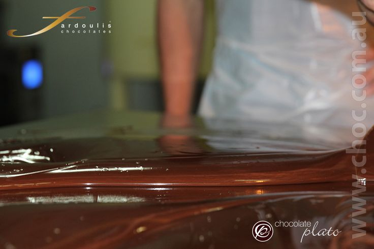Learning how to make chocolate by hand temepering  pure couverture at the Fardoulis Chocolates factory Sydney Australia www.choc.com.au