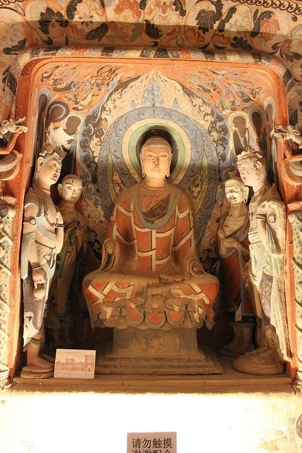 The Mogao Caves, or Caves of the Thousand Buddhas, form a system of 492 temples 25 km (16 mi) southeast of the center of Dunhuang, an oasis strategically located at a religious and cultural crossroads on the Silk Road, in Gansu province, China.