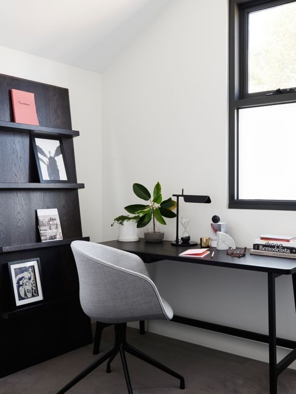 """House tour: a private home for one in inner-city Melbourne: """"Another example is the way she works in her home study, to allow for the display of notices on a bespoke leaning shelf."""" Hay About A Chair 'AAC21' and desk accessories, all from Cult. Arflex 'Ponti' writing desk from Poliform. Flos 'Tab T' desk lamp from Euroluce."""