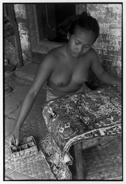 Henri Cartier-Bresson // Indonesia, 1949 -- Bali. Painting is a man's work in Bali. Women, traditionally weave. But since the war, textile is lacking and so this girl does a man's work.