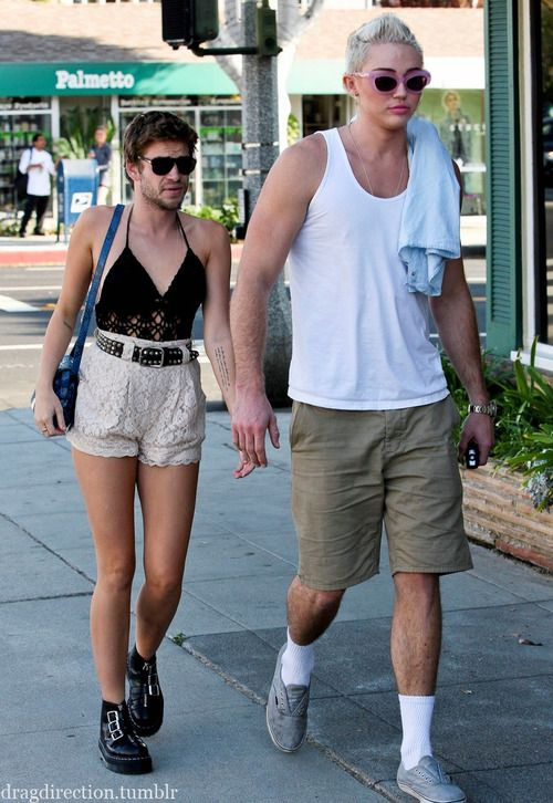 It's hard to see the heads back where they belong! Miley Cyrus and Liam Hemsworth.