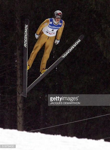 France's David Lazzaroni flies during his qualification jump of the 8th competition of the World Cup SkiJumping 19 December 2004 in Engelberg...