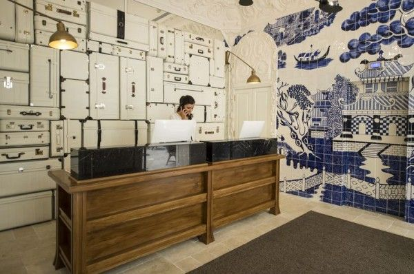 Only You Hotel Madrid reception, elevators camouflaged with blue and white Chinoiserie scene painted onto a tile wall.