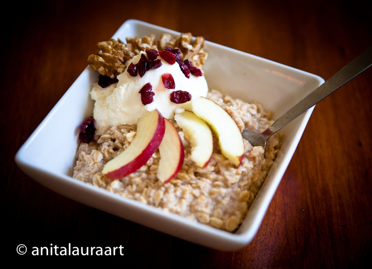 Oatmeal with cranberries, apple, walnuts, greek yogurt and a drizzle of maple syrup