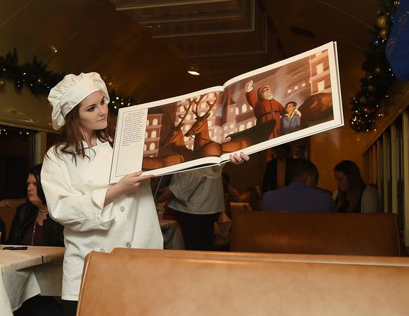 Brettni Banks displays pages from the Polar Express book during the Polar Express train ride at the Texas State Railroad in Palestine Monday Nov. 15, 2016. (Sarah A. Miller/Tyler Morning Telegraph)