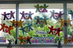 Friendship Bulletin Board Ideas. With heart in between hands for confetti if done with contact paper.