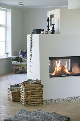 I am loving these see-through fireplaces!