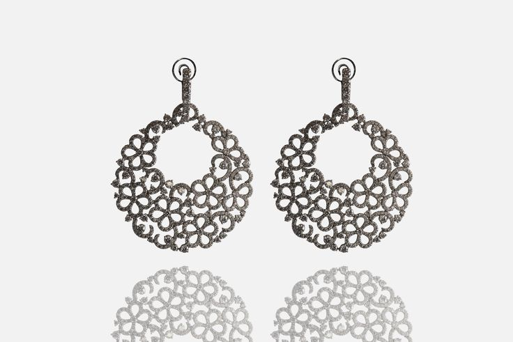 Earrings in 18 Kt white gold with natural white diamonds 10.62 ct