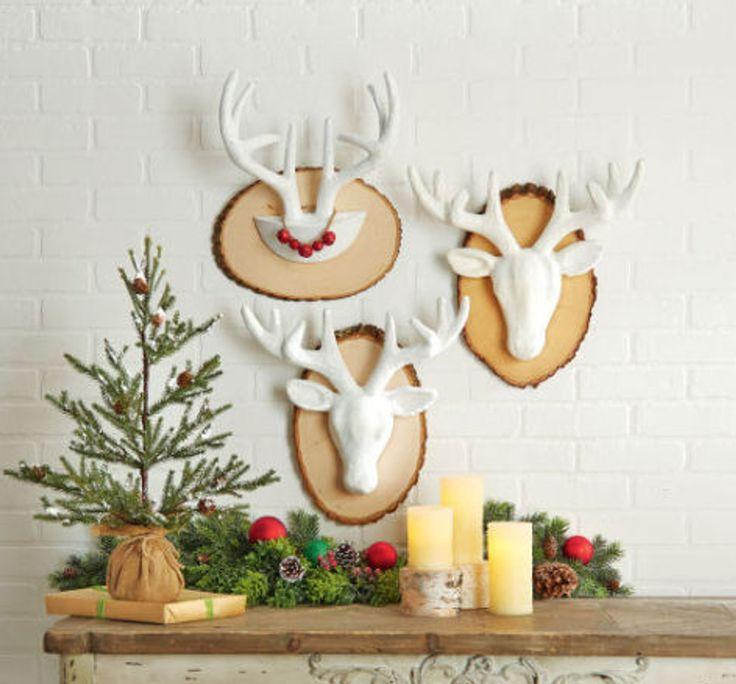 paper mache deer head mounted on wood block